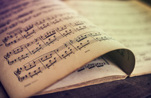 Music Sheets On Wooden Backgro...