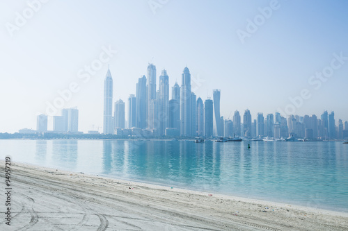 Hazy dubai marina skyline shot from the palm Poster