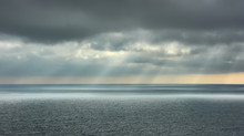 Beautiful Seascape. Landscape With Dramatic Clouds Over The Sea And Rays Of Sun.
