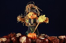 Autumn Decoration - Scarecrow With Pumpkins And Chestnuts