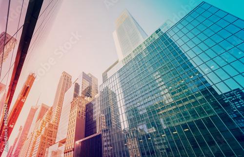 Fotomagnes Roczników stonowani Manhattan drapacze chmur przy zmierzchem, NYC, usa