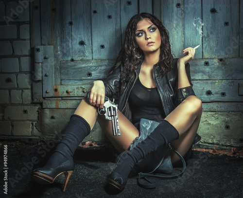Photo  Brutal Girl with big gun, smoking.