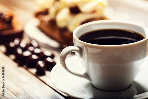Photo  Cup of coffee with assorted desserts