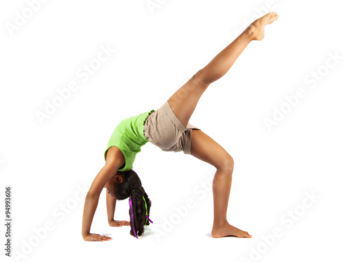 Deurstickers Gymnastiek Young baby artistic gymnast doing bridge