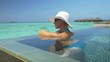 Woman bathing in the private ocean pool in Maldives