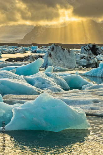 Poster Glaciers Melting of icebergs at Jokulsarlon glacier lagoon at sunset