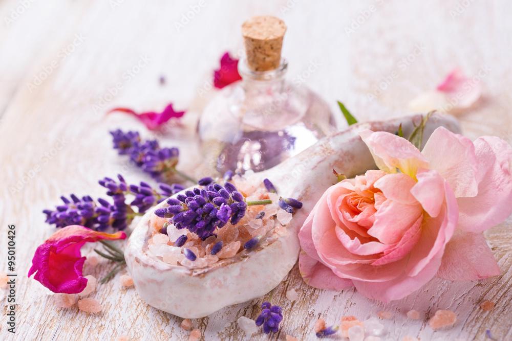 Fototapeta Spa still life with lavender, bathing salt, massage oil and rose flower