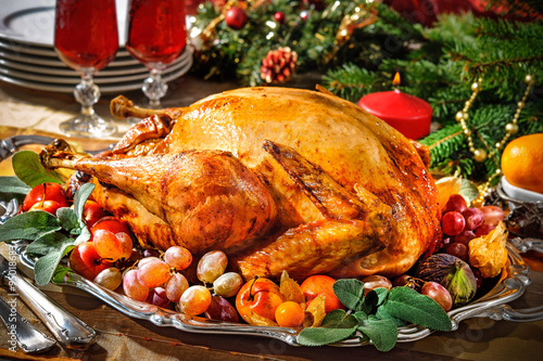 Fotografia  Roasted turkey on holiday table