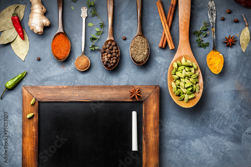 Various Spices near blackboard Wallpaper Mural