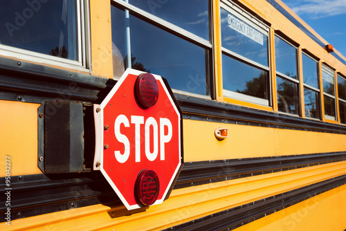 Fotografie, Tablou Stop sign on yellow school bus