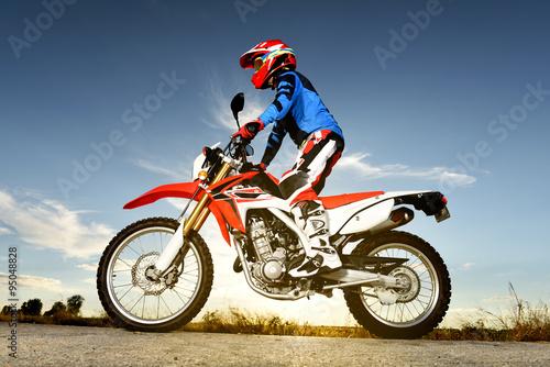 Photo  Man With Motocross Byke