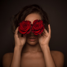 Portrait Of Professional Model Girl With Red Roses