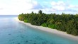 AERIAL: Amazing sandy beach and turquoise water in exotic Maldives