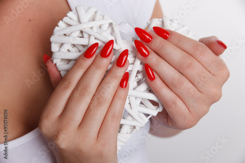 Closeup of a woman hand with red nails Fototapeta