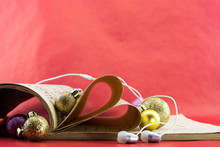 Music Notation Book With Pages Shaping Heart With Earphones And Christmas Ornaments