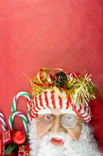 Foto op Aluminium Carnaval Santa on red with Christmas ornaments and copy-space