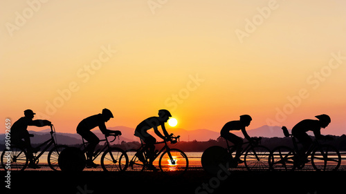 Spoed Foto op Canvas Fietsen Cycling at the beach twilight time