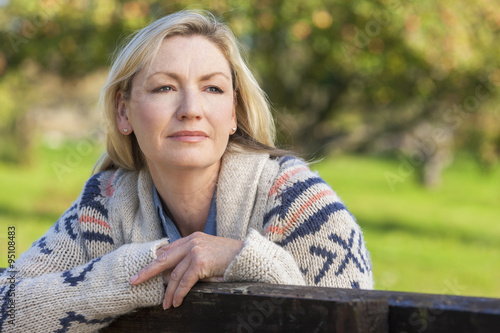 Fotografía  Attractive Thoughtful Middle Aged Woman Resting on Fence