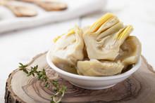 Artichoke Hearts Marinated In Olive Oil A Small White Bowl