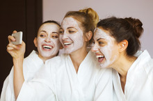 Three Young Happy Women With Face Masks At Spa Resort. Frenship