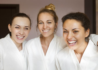 Three young happy women at spa resort