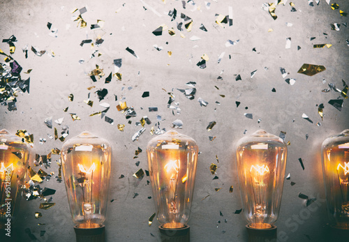 Tableau sur Toile NYE: Border Of Bulbs Beneath Grungy Copy Space