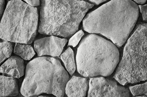 background the wall which is laid out by a stone limestone in black and white #95126858