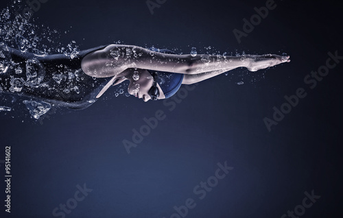 Canvas Print Female swimmer. Concept image