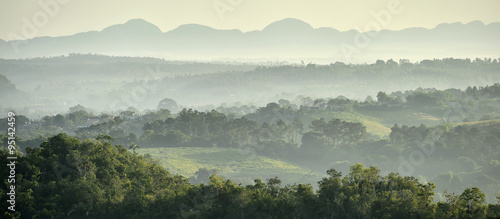 View across the Vinales Valley in Cuba. Morning twilight and fog. Canvas Print