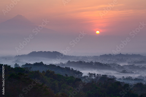 Sunrise at Setumbu hill with the view of Borobudur and  Merapi Canvas Print