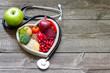 Leinwanddruck Bild - Healthy food in heart and cholesterol diet concept on vintage boards