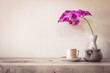 Teapot and flower, home decoration concept