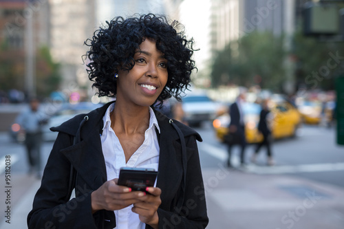 Business woman in New York City texting cell phone Wallpaper Mural