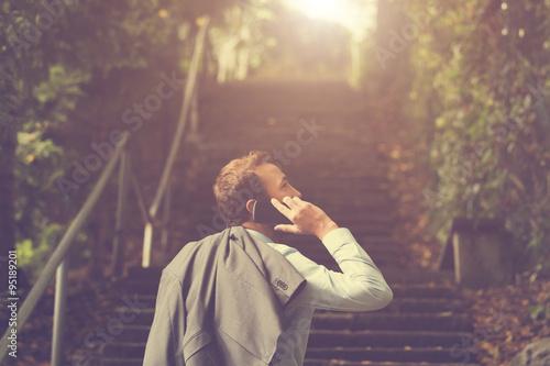 Fotografía  Young handsome man using smartphone.