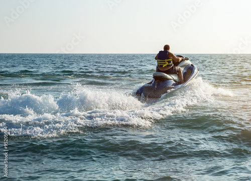 Foto op Plexiglas Water Motor sporten Silhouette of man on jetski at sea