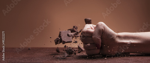 Fotografie, Obraz  Female hand destroying chocolate and diet letterbox