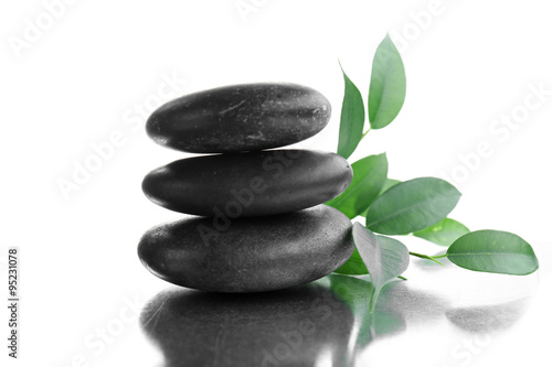 Tuinposter Zen Stack of stones and a green flower, isolated on white. Spa relaxation concept