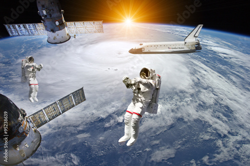 Deurstickers Nasa Astronauts, Space Station and Shuttle in outer space - Elements of this image furnished by NASA