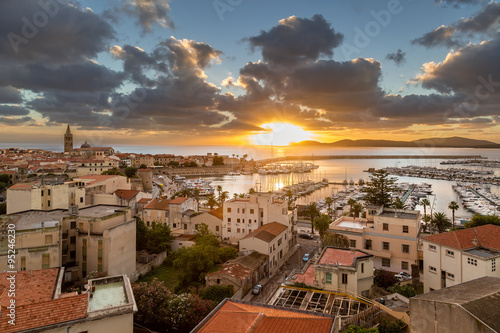 Sunset over city of Alghero on west coast of Sardinia Wallpaper Mural