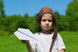 Portrait of a boy with a paper airplane