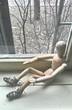 Depressed wooden figurine on windowsill