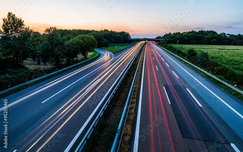 Poster Nacht snelweg Sunset long-exposure over a german highway