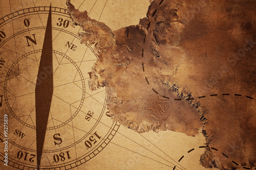 Papiers peints Retro intage Travel old Map and Compass Over color Background , Elements of this image furnished by NASA (Satellite map of Antarctica)