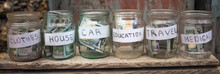 Glass Jars With Dollars And Te...