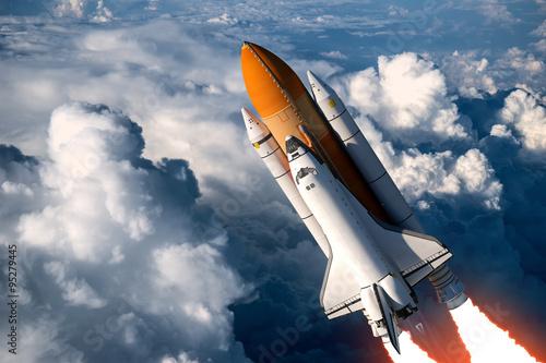Fototapeta Space Shuttle Launch In The Clouds obraz na płótnie