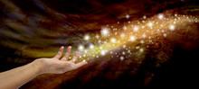 Creating Magic - Female Open Hand Appearing To Send Out A Stream Of Sparkles And Glitter On A Golden And Black Flowing Background