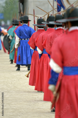 Row of armed guards in ancient traditional soldier uniforms in the old royal residence, Seoul, South Korea Poster