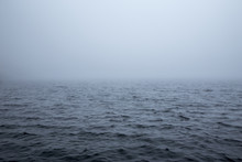 Calm Surface Of A Sea During A Foggy Day