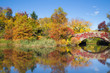Colorful autumn view of Central Park in New York City at landmark Gapstow Bridge
