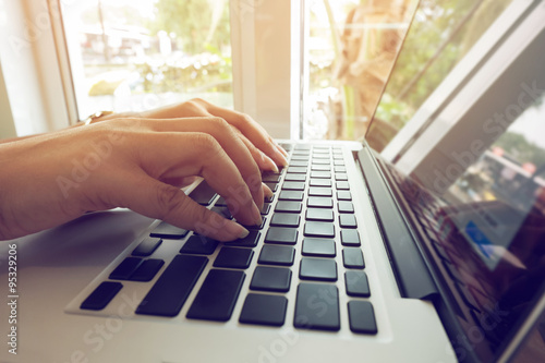 Fototapety, obrazy: woman office worker typing on a keyboard of laptop notebook